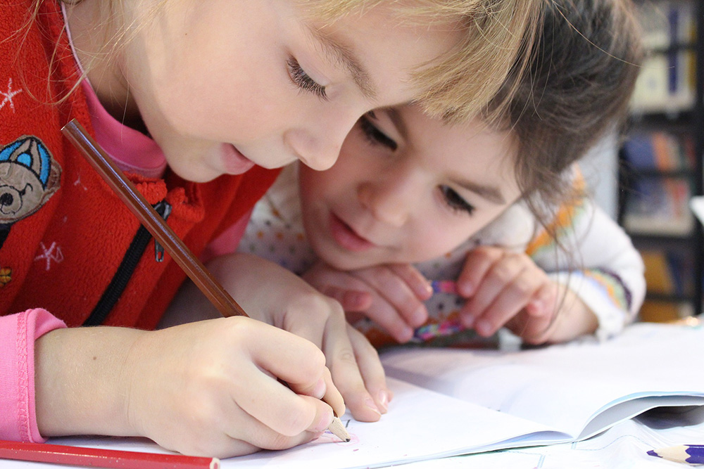 children doing schoolwork together